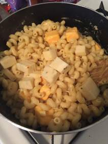Mix pasta with melted cheese